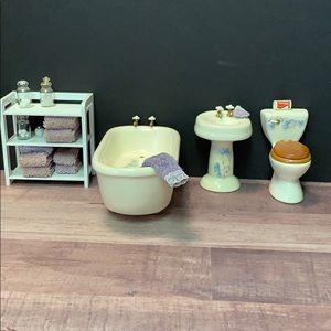 Miniature porcelain bathroom dollhouse furniture.